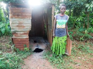 The Water Project:  Josephine Next To A Dangerous Latrine