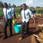 The Water Project: Immaculate Heart Secondary School -  Carrying Water
