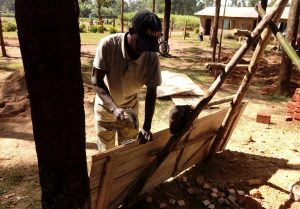The Water Project:  Making A Latrine Door