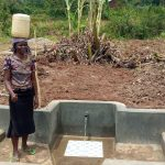 The Water Project: Shirugu Community, Jeremiah Mashele Spring -  Flowing Water