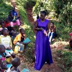 The Water Project: Chepnonochi Community, Chepnonochi Spring -  Handing Out New Notebooks And Pens