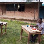 The Water Project: Kapkemich Primary School -  Teachers Outside Grading