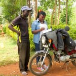 The Water Project: Mutao Community, Kenya Spring -  Field Officer Jacky Interviewing