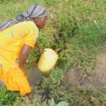 The Water Project: Eshiakhulo Community, Asman Sumba Spring -  Fetching Water