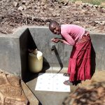 The Water Project: Upper Visiru Community, Wambosani Spring -  Water Flowing