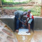 The Water Project: Koloch Community, Solomon Pendi Spring -  Water Flowing