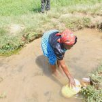 The Water Project: Sichinji Community, Kubai Spring -  Fetching Water