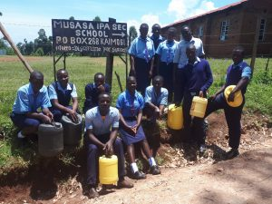 The Water Project:  Posing With Water Containers