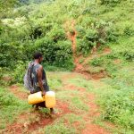 The Water Project: Mutao Community, Shimenga Spring -  Woman Walking To The Spring