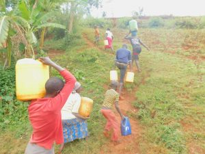 The Water Project:  Carrying Water Up The Slope
