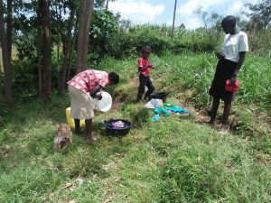 The Water Project:  Washing Clothes By The Spring