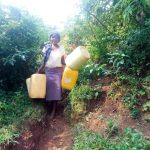 The Water Project: Mutao Community, Shimenga Spring -  Carrying Containers