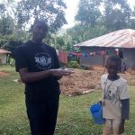 The Water Project: Asimuli Community, John Omusembi Spring -  Handwashing Training