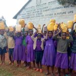 The Water Project: Munyanza Primary School -  Posing With Jerrycans