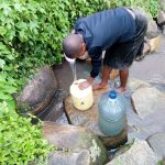 The Water Project: Imbinga Community, Arunga Spring -  Fetching Water