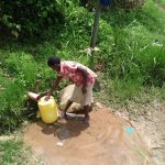 The Water Project: Shihungu Community, Shihungu Spring -  Fetching Water