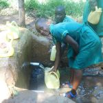 The Water Project: Friends School Mutaho Primary -  Fetching Water In Community