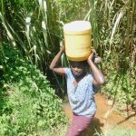 The Water Project: Ataku Community, Ngache Spring -  Carrying Water