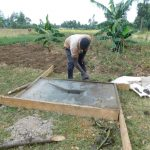 The Water Project: Lunyi Community, Fedha Mukhwana Spring -  Latrine Platform Construction
