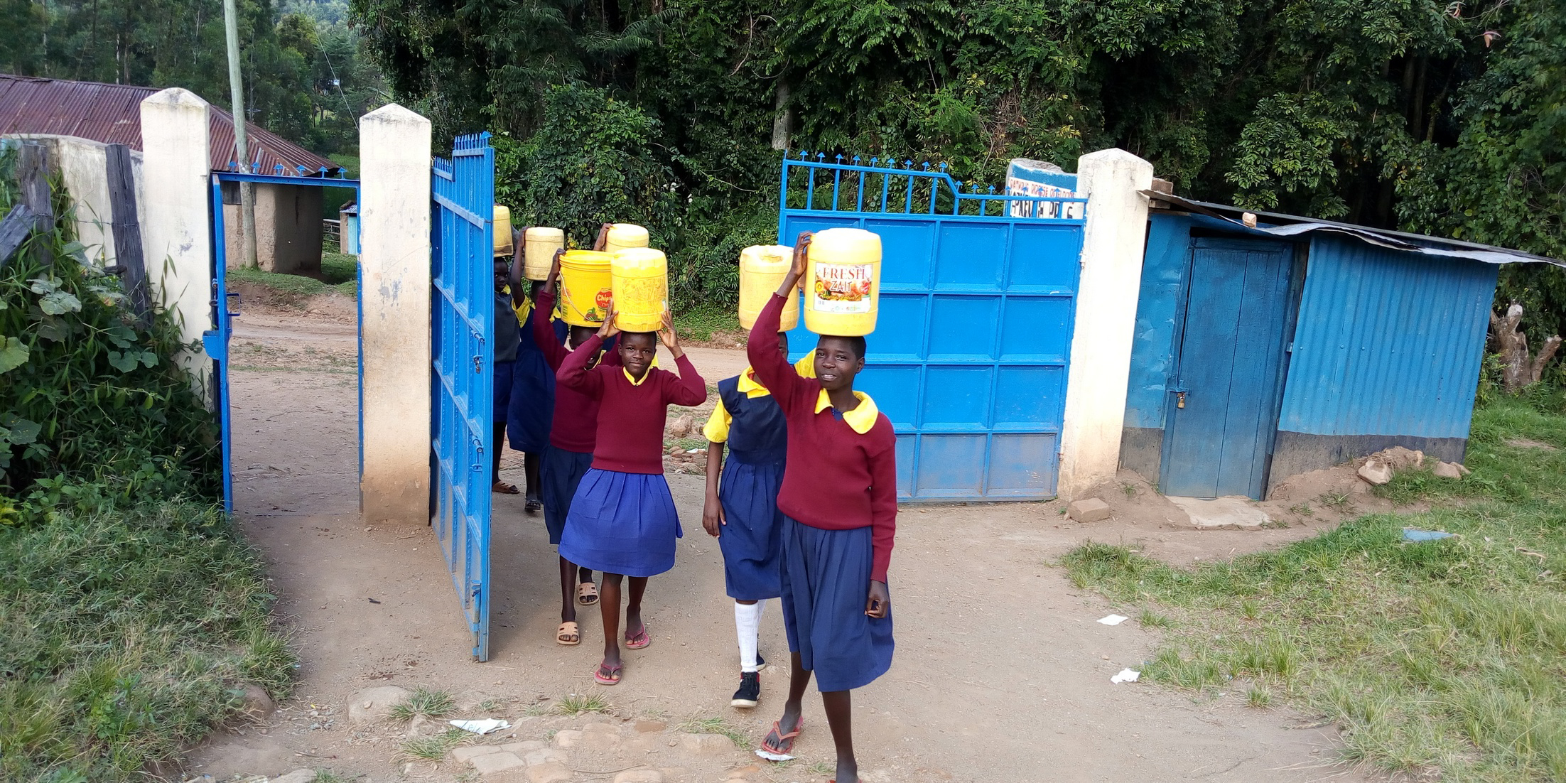 The Water Project : 9-kenya19022-arriving-at-school-with-water-again