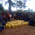 The Water Project: Essongolo Primary School -  Pupils With Jerrycans