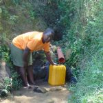 The Water Project: Emukangu Community, Okhaso Spring -  Fetching Water