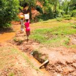 The Water Project: Mutao Community, Kenya Spring -  Carrying Water Home