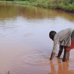 The Water Project: Kathuli Community -  Collecting Water From The River