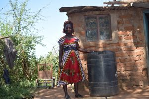 The Water Project:  Standing With Water Container