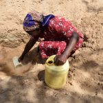 The Water Project: Tulimani Community -  Collecting Water
