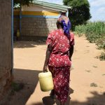 The Water Project: Tulimani Community -  Returning Home With Water