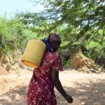The Water Project: Tulimani Community -  Woman Carrying Water