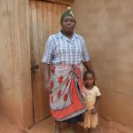 The Water Project: Katovya Community -  Mary Stands With Her Daughter