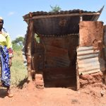 The Water Project: Kathuli Community A -  Standing Outside Of Latrine