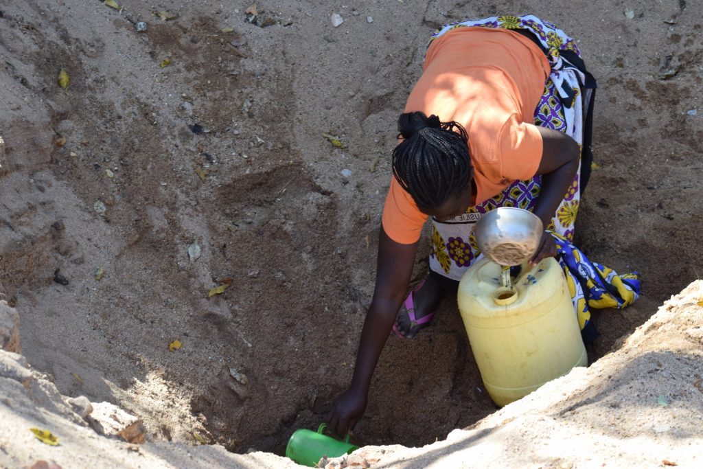 The Water Project : kenya19223-gathering-water-at-the-scoop-hole