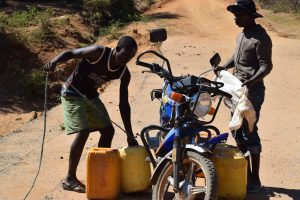 The Water Project:  Preparing To Put Fetched Water Onto Motorbike