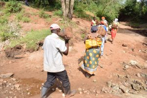 The Water Project:  Carrying Rocks For Project