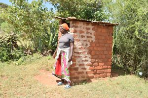 The Water Project:  Standing Outside Of Latrine