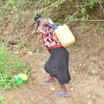 The Water Project: Mbiuni Community A -  Carrying Water