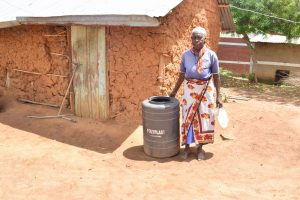 The Water Project:  Standing With Water Storage Container