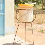 The Water Project: Kyamatula Secondary School -  Bucket For Handwashing Near Girls Bathroom