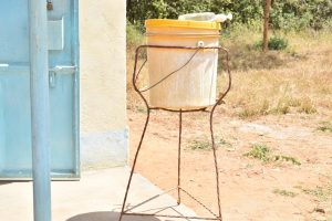 The Water Project:  Bucket For Handwashing Near Girls Bathroom