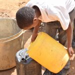 The Water Project: AIC Kyome Boys' Secondary School -  Filling Containers With Water