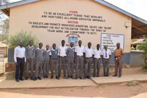 The Water Project:  Students Pose In Front Of School Vision And Mission Sign
