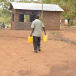 The Water Project: Matiliku Primary School -  Carrying Water