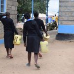 The Water Project: Kiundwani Secondary School -  Girls Carrying Water