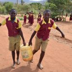 The Water Project: Nguluma Primary School -  Carrying Water