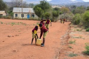 The Water Project:  Picking Up Container With Water