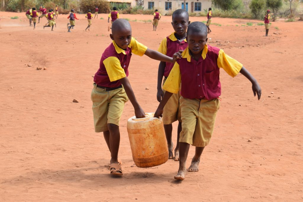 The Water Project : kenya19254-younger-students-carrying-water