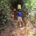 The Water Project: Mummy Ann's Pre-Primary School -  Boys Carrying Water For The School